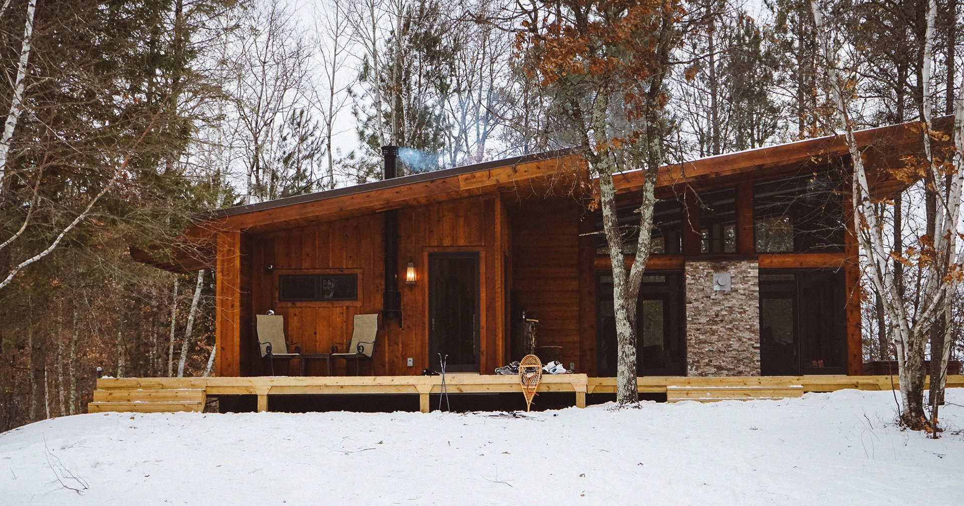 Log cabin in the woods winter - By Alex Lauer